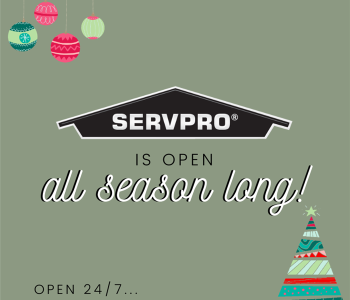 Green background with holiday décor in oposite corners of photo. Black SERVPRO logo in center with words stating our hours