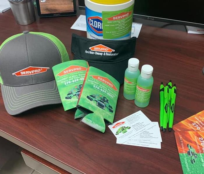 Table filled with SERVPRO SWAG in an office we recently disinfected